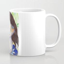 Girl and exotic blue flowers Coffee Mug