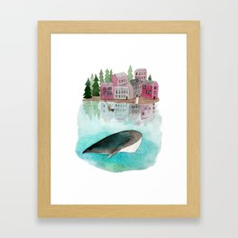 A whale is passing by Framed Art Print