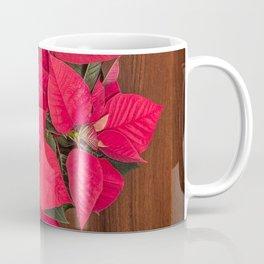 Red Christmas flower on brown wood Coffee Mug