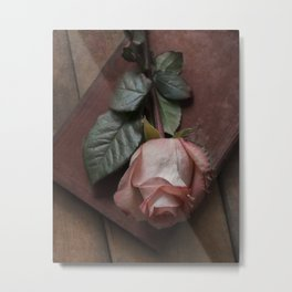 Pink rose and red old book Metal Print