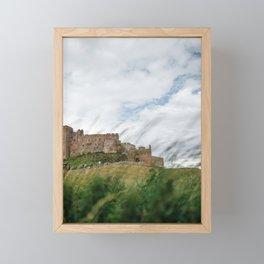 Bamburgh castle through the wild sea grass, Northumberland, England. Framed Mini Art Print