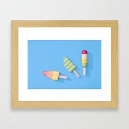 Three Ice Lollies on Blue Framed Art Print
