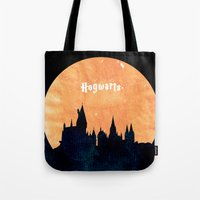 hogwarts Tote Bags featuring Hogwarts by IA Apparel