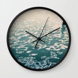 Lady in swimming pool Wall Clock