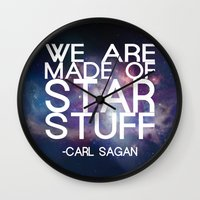 carl sagan Wall Clocks featuring Carl Sagan Quote - Star Stuff by Yellow Bird Designs