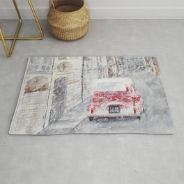 Snowfall and little red car Rug