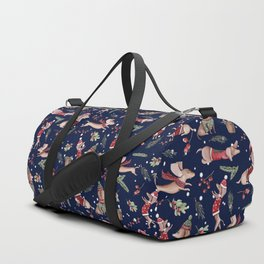 Dachshund in the snow on blue Duffle Bag