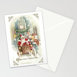 Santa Claus driving a motorcar amid happy children Stationery Cards