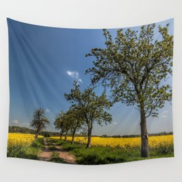 Spring landscape - a trail in the rapeseed Wall Tapestry