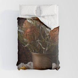 ORANGE - FLOWERS - IN - BROWN - VASE - BESIDE - SLICED - ORANGE - FRUIT - PHOTOGRAPHY Comforters