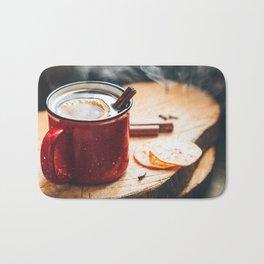 Mulled wine in a red ceramic mug Bath Mat
