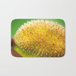 Macro shot of canna indica fruit Bath Mat