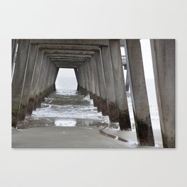 Under the fishing pier with waves Canvas Print