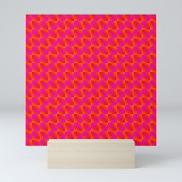 Chaotic pattern of bright pink rhombuses and orange triangles in a zigzag. Mini Art Print