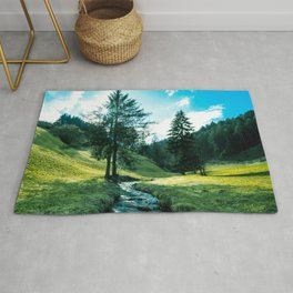 Green fields, trees and a magical brook Rug