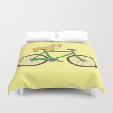Corgi on a bike Duvet Cover