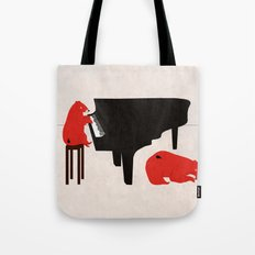 A Sleepy bear playing piano Tote Bag