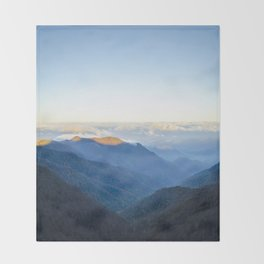 Clouds over mountains  Throw Blanket