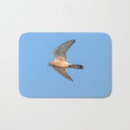 Common Kestrel (Falco tinnunculus). Common Kestrel in flight Bath Mat
