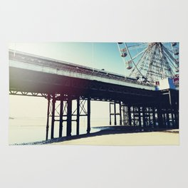 Ferris wheel and pier with light leak Rug