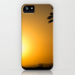 Golden Andalusian sunset with silhouette palm trees and mountain iPhone Case