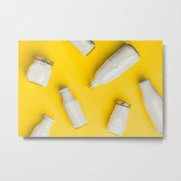 Various bottles of milk on yellow background Metal Print