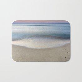 """Serenity"". Sunset at the beach Bath Mat"