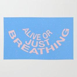 alive or just breathing Rug