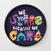 risa rodil Wall Clocks featuring We Scare Because We Care by Risa Rodil