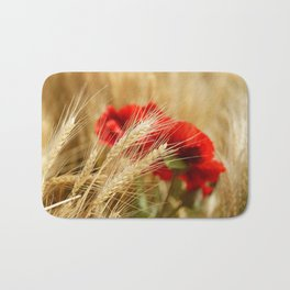 Field of golden wheat with red poppy flowers Bath Mat