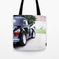 volkswagon Tote Bags featuring Vintage Volkswagon Beetle by istillshootfilm