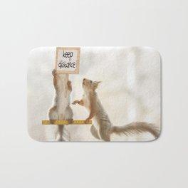 squirrels keeping distance Bath Mat