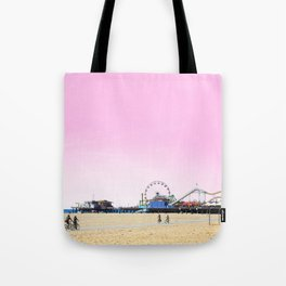 Santa Monica Pier with Ferries Wheel and Roller Coaster Against a Pink Sky Tote Bag