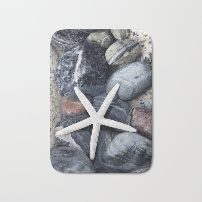 Starfish and pebble on beach Bath Mat
