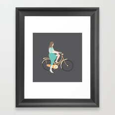 Girl on a bike Framed Art Print