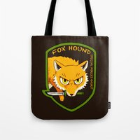 metal gear solid Tote Bags featuring Metal Gear Solid - Chibi Foxhound by feriowind