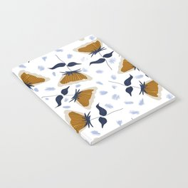 Gold and White Flowers with Blue Notebook