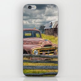 Pickup Truck behind wooden fence in a Rural Landscape iPhone Skin