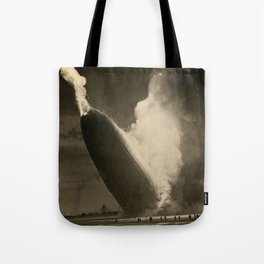 The Hindenburg hits the ground in flames in Lakehurst, N.J. Tote Bag