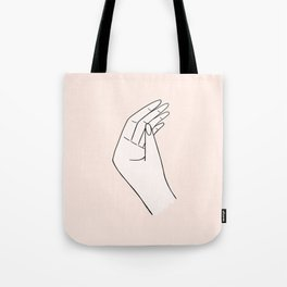 Hand on Pink Background Tote Bag
