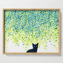 Cat in the garden under willow tree Serving Tray