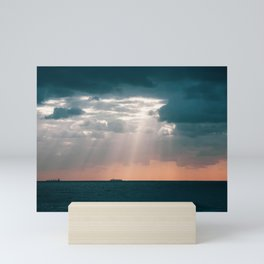 Shafts of light breaking through the clouds. Bondi Beach. Sydney Australia. Mini Art Print