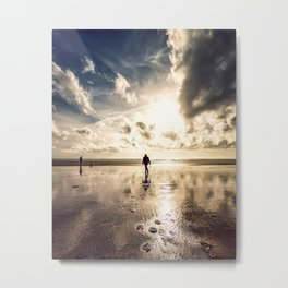 Silhouetted woman on a bright sunny beach Metal Print