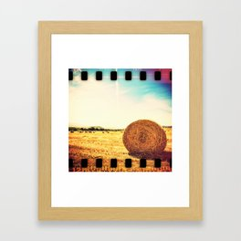 hay bale in a wheat field Framed Art Print