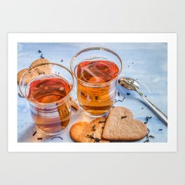 Black tea in two tea glasses with heart shaped ginger cookies on pastel background Art Print