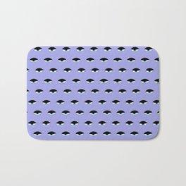 Sleepy Eyes (purple) Bath Mat