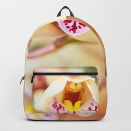 Pink and yellow orchids Backpack