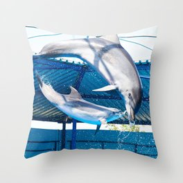 Dolphins jumping out of water on show Throw Pillow
