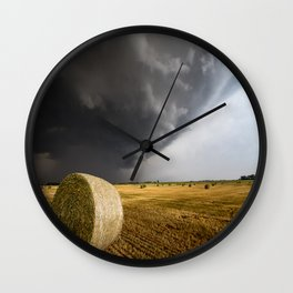 Spinning Gold - Storm Over Hay Bales in Kansas Field Wall Clock