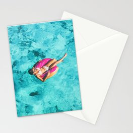 Drone aerial top view of beach vacation woman relaxing in donut float on turquoise ocean Bora Bora Stationery Cards